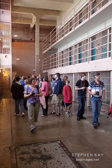 Tourists walking throught the cell blocks. Alcatraz prison, California.