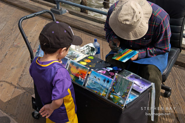 Artist and child at Santa Monica Pier. Santa Monica, California, USA.