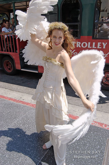 Actress in angel costume outside Grauman's Chinese Theater., Hollywood, California, USA.