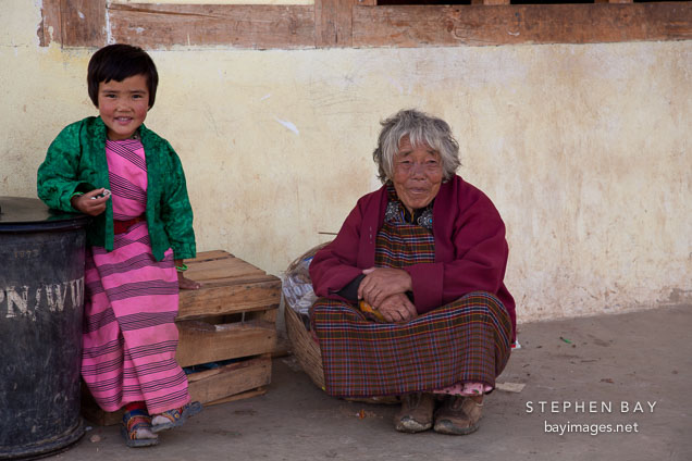 Young girl with grandmother at Gante Goemba. Phobjikha Valley, Bhutan.
