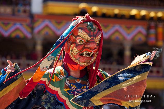 Dancer with frightening mask and brocade dress. Thimphu tsechu, Bhutan.
