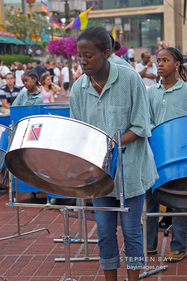 Girl playing steel drums. Baltimore, Maryland, USA.