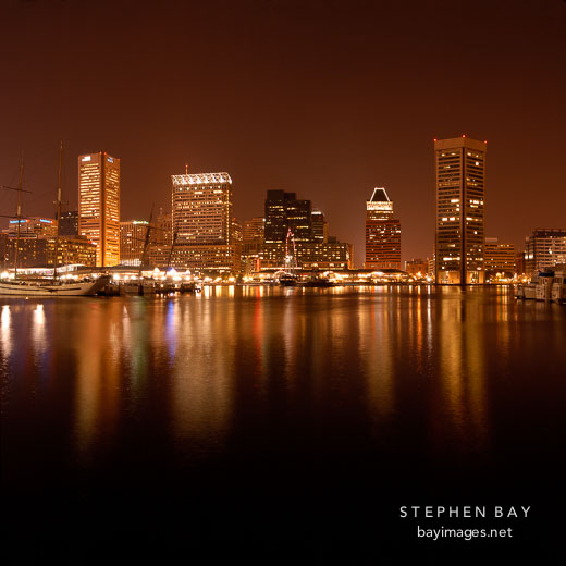 Skyscrapers and their reflections on the Inner Harbor. Baltimore, Maryland, USA.