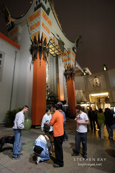 Tourists at Grauman's Chinese Theatre (Mann's Chinese Theatre). Hollywood, Los Angeles, California, USA.