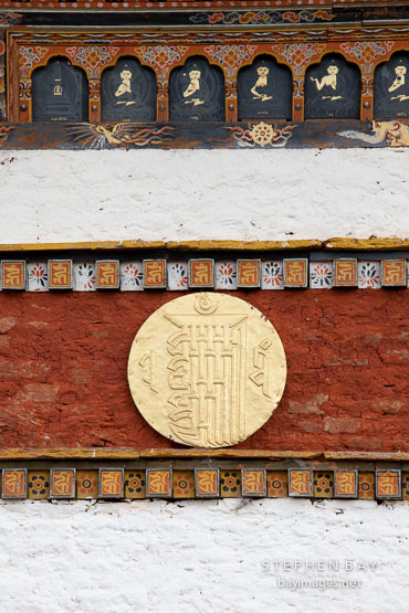 Embossed gold disk on the central chorten. Druk Wangyal Chorten, Dochu La, Bhutan.