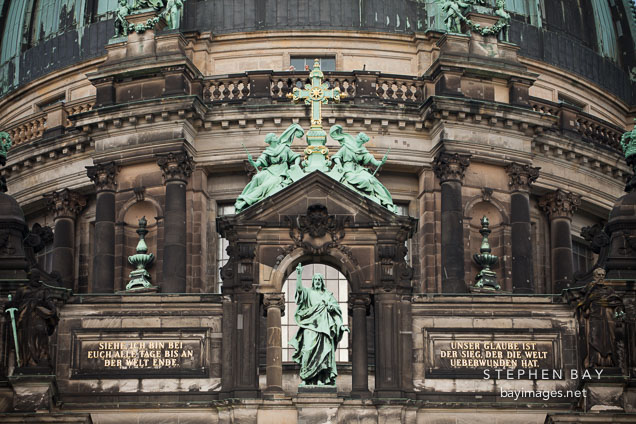 Bronze statues and cross on the Berlin Cathedral. Berlin, Germany.