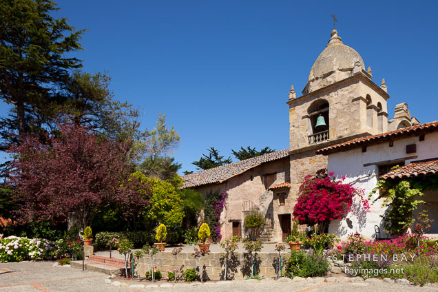 Courtyard and bell tower at Carmel Mission. Carmel, California.
