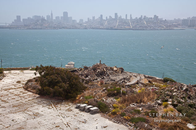 Rubble on Alcatraz Island with San Francisco in the background.