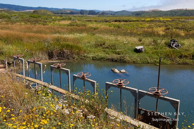 Flood control gates at Pescadero march, California, USA.