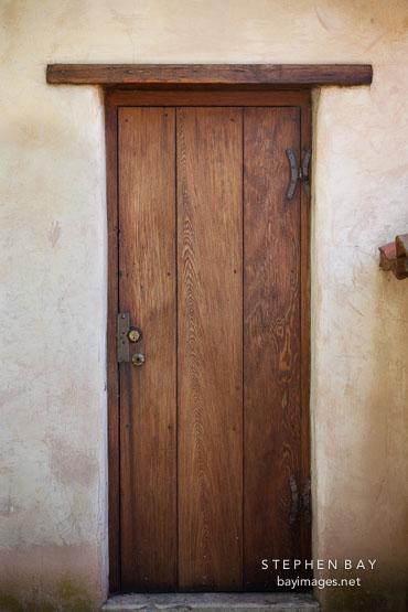 Narrow wooden door. Carmel Mission California. & Photo: Narrow wooden door. Carmel Mission California.