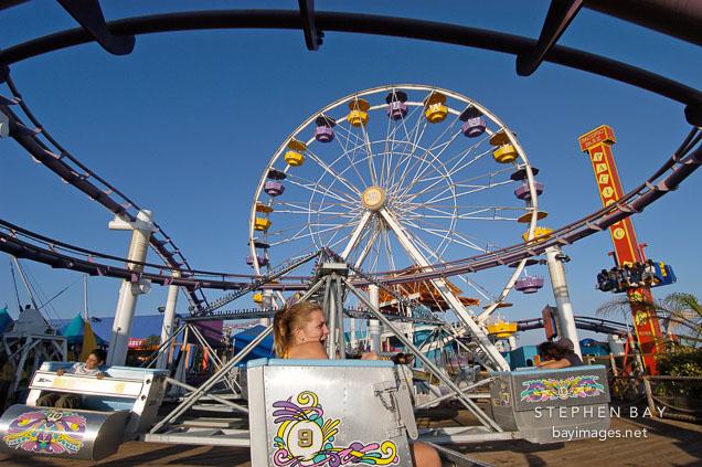 Amusement park rides at Santa Monica Pier. Santa Monica, California, USA.