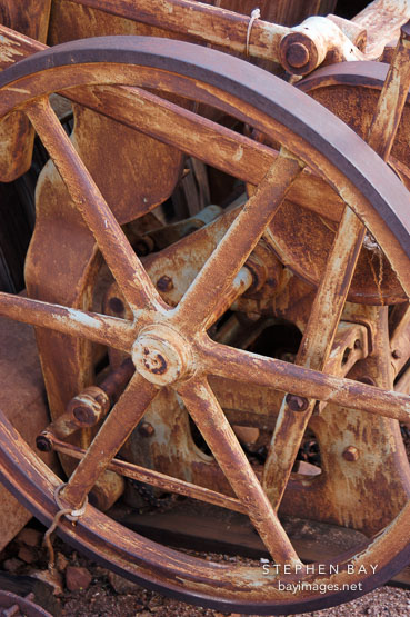 Rusted wheel on a Chandler & Price New Series press. Goldfield, Phoenix, Arizona, USA.