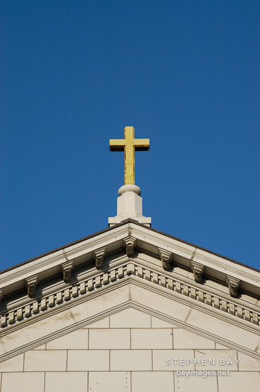 Golden cross on top of St. Joseph's Cathedral (Cathedral Basilica of St. Joseph). San Jose, California, USA.
