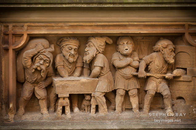Heinzelmannchen fountain with gnomes baking bread. Cologne, Germany.