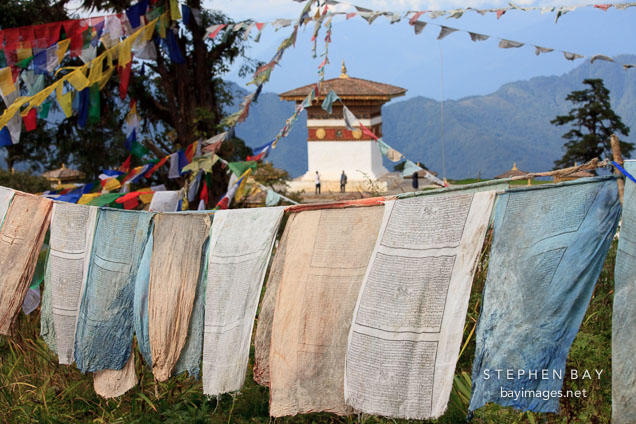 Prayer flags and the central chorten. Druk Wangyal Chorten, Dochu La, Bhutan.