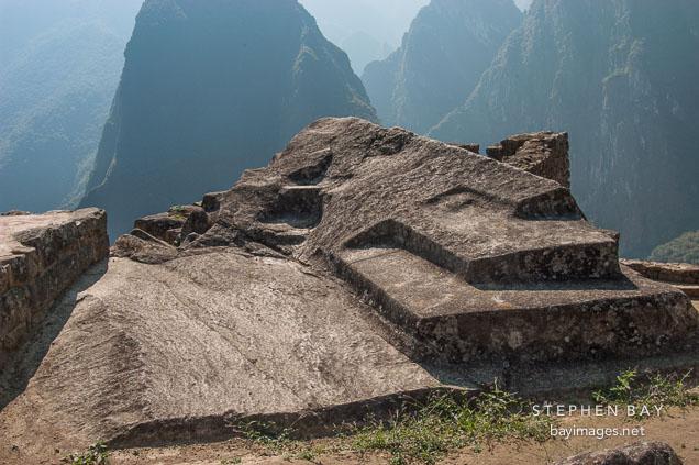 Photo carved stone altar machu picchu peru
