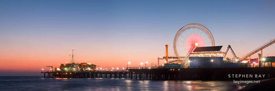 Santa Monica Pier and ferris wheel panorama. Santa Monica, California.