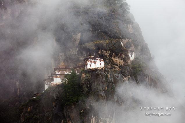 Taktshang Goemba hidden amongst the clouds. Paro Valley, Bhutan.