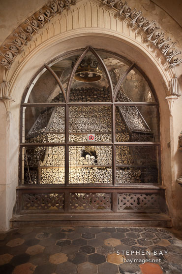 Bones arranged in huge, loose pile. Sedlec Ossuary, Czech Republic.