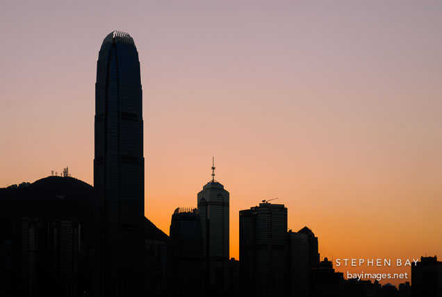 Silhouette of modern skyscrapers during sunset. Hong Kong, China.