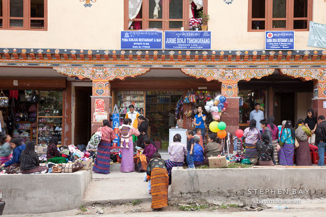 People crowded on Norzin Lam street buying and selling merchandise. Thimphu, Bhutan.