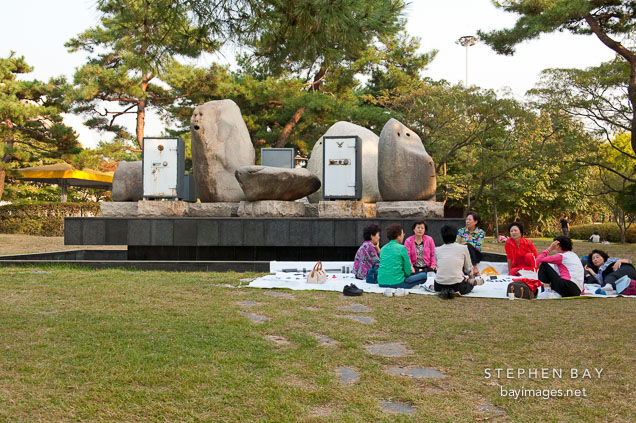 Women Enjoy A Picnic In Front Of Artist Erik Dietmans Sculpture Yesterday And The Day