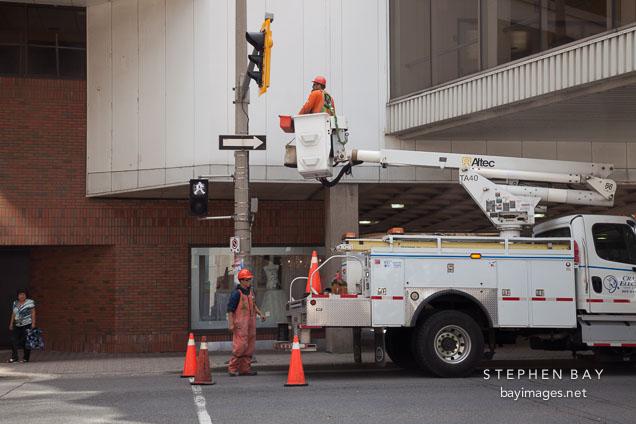 Work crew fixing traffic lights. Hamilton, Canada.