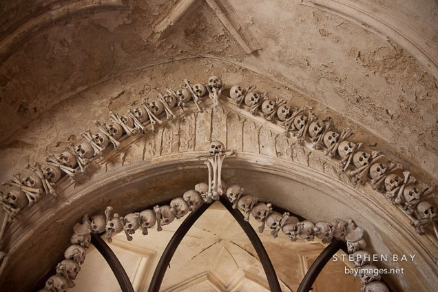 Bones decorating the ceiling vault. Sedlec ossuary, Czech Republic.