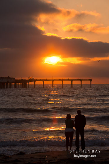 Couple on Ocean beach at sunset. San Diego, California.