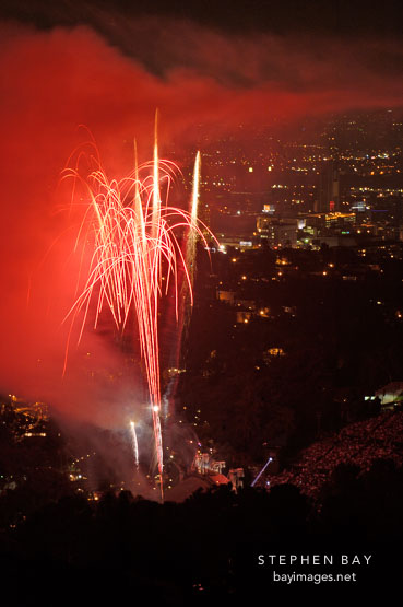 Fireworks at the Hollywood bowl seen from Mulholland Drive. Los Angeles, California, USA.