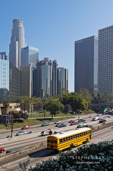School bus on the Harbor Freeway (110). Los Angeles, California, USA