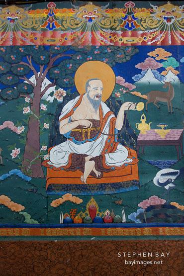 Wall mural of old man in Rinpung dzong. Paro, Bhutan.