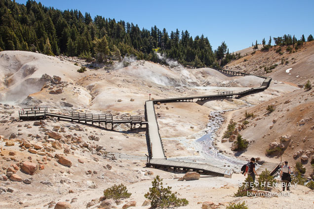 Hikers at Bumpass Hell. Lassen NP, California.