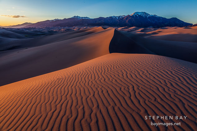 Red dunes at sunset. Great Sand Dunes NP, Colorado.