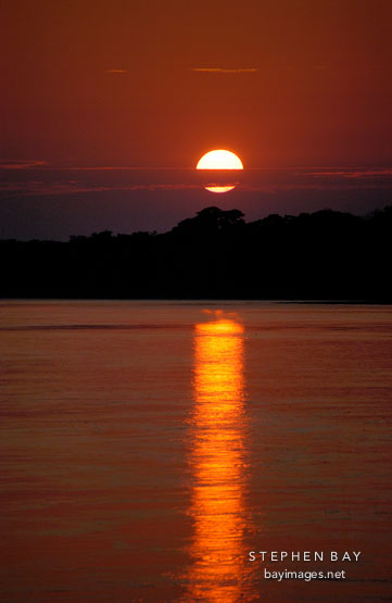 Sunrise over the Madre de Dios river. Amazon, Peru.