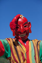 Clown wearing a mask (atsara baup) with a cloth phallus on top. Thimphu tsechu, Bhutan. - Photo #22700