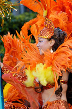 Woman with orange feathers. Carnaval's grand parade. San Francisco, California, USA. - Photo #6200