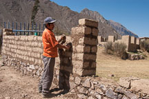 Laborer building a brick wall. Sacred Valley, Peru. - Photo #9202