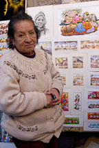 Woman selling prints Pisac market, Sacred Valley, Peru. - Photo #9082