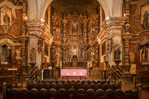 The main altar and reredos of the mission is dedicated to Saint Francis Xavier. Mission San Xavier Del Bac, Tucson Arizona. - Photo #47211