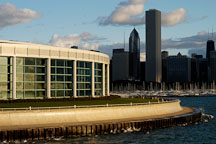 Glass windows of the Shedd Aquarium reflect the warm morning light of sunrise. Chicago, Illinois, USA. - Photo #10703