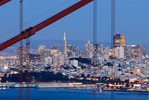 San Francisco skyline seen throught the cables of the Golden Gate Bridge. California, USA. - Photo #11724