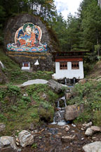 Painting of Guru Rinpoche and small stream. Road from Thimphu to Punakha, Bhutan. - Photo #23113