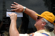 Pencil rubbing by volunteer. Vietnam Veteran's Memorial Wall, Washington, D.C., USA. - Photo #12706