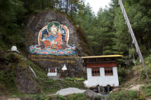 Guru Rinpoche painted on a rock wall. Road from Thimphu to Punakha, Bhutan. - Photo #23114