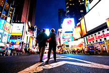 Couple walking in the middle of the street. Times Square, New York City, New York, USA. - Photo #13091