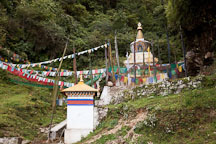 Chorten and prayer flags along side the road. - Photo #23215