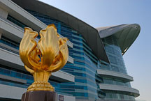 Golden Bauhinia statue in front of the Hong Kong Convention center. Hong Kong, China. - Photo #14554