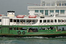 Star Ferry pulling into Kowloon Pier. Hong Kong, China - Photo #15305