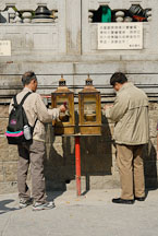 Two men lighting incense at the Wong Tai Sin Temple. Hong Kong, China. - Photo #15825